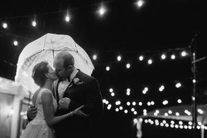 rainy nighttime wedding portrait of bride & groom at Gold Canyon Golf Resort